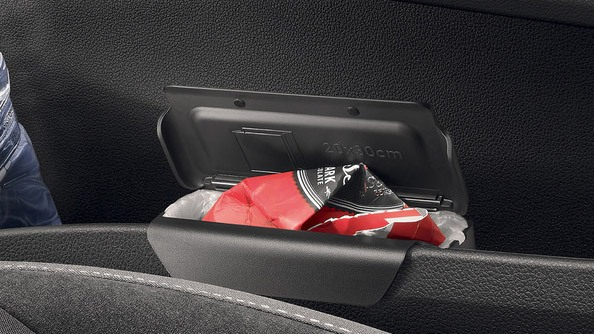 "Wastebasket Kids are experts at building up little piles of rubbish on a journey, so ŠKODA offers a ""Simply Clever"" and highly useful solution: a little wastebasket that clips onto the storage well of the passenger door and is easy to slide out whenever you want to empty the bag."